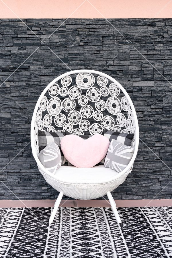 round chair with pink heart pillow