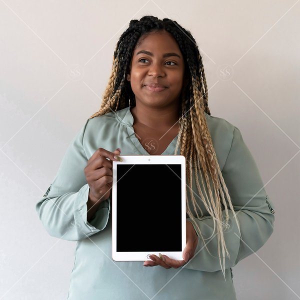 woman of color holding a tablet mockup