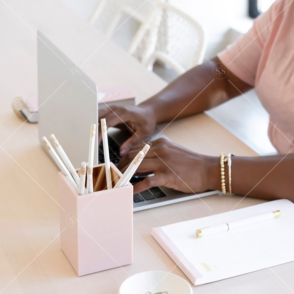 woman of color working on a laptop