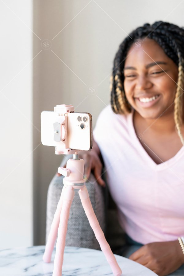 woman of color filming on phone