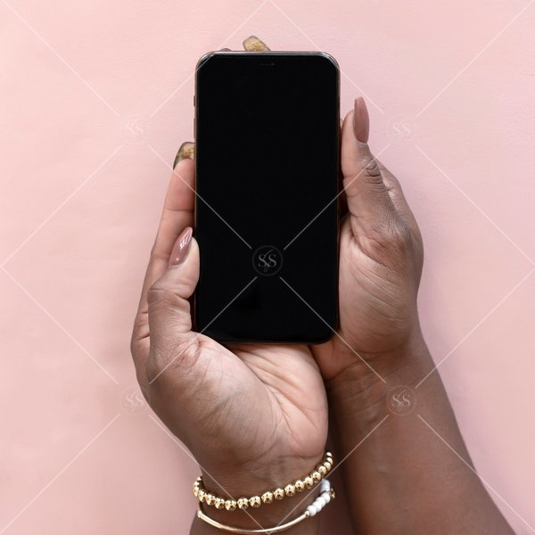 woman of color holding mockup of phone