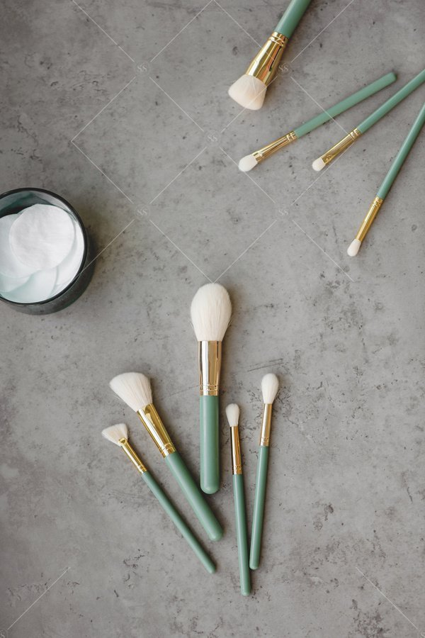 makeup brushes on cement vanity
