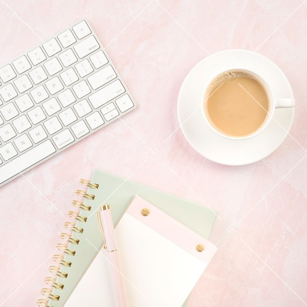 pink background styled desktop with coffee and keyboard