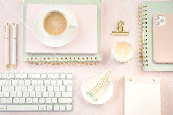 blush pink styled desktop with coffee and keyboard