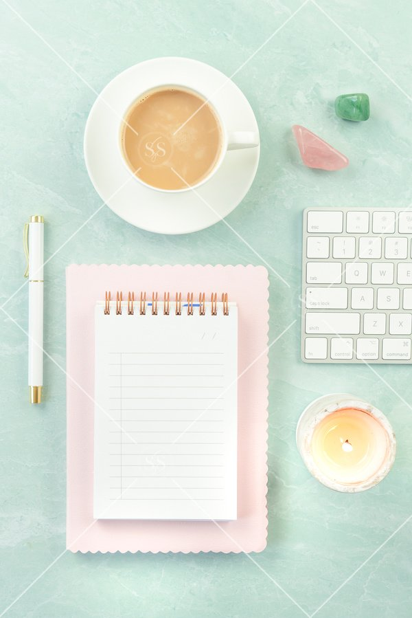 Styled desktop stock photo with coffee, keyboard, and notepad