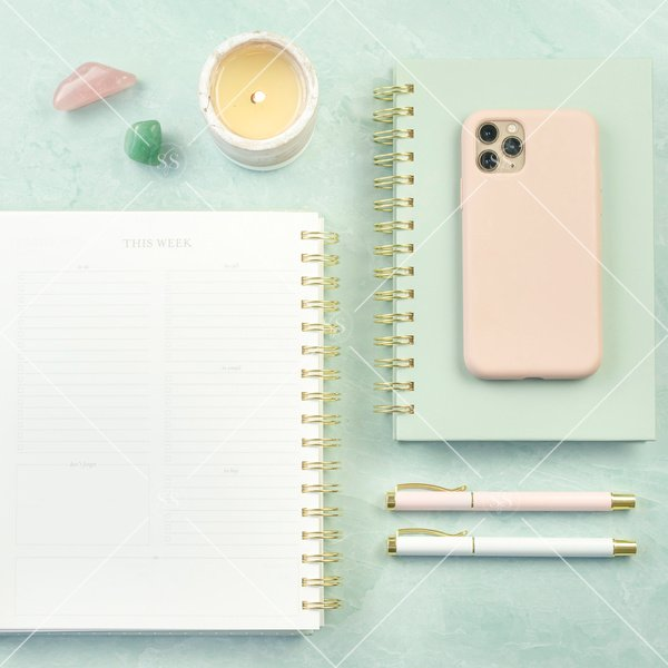 notebook with iPhone and pens