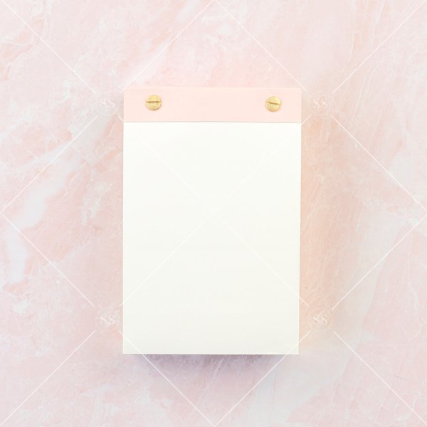 pink notepad on pink background