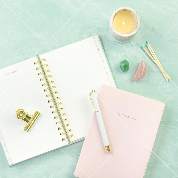 notebook with crystals and candle
